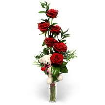 Polatlıdaki çiçekçiler  cam yada mika vazo içinde 7 adet kirmizi gül ve oyuncak